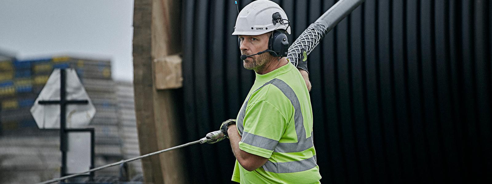 NKT worker installing HV cable